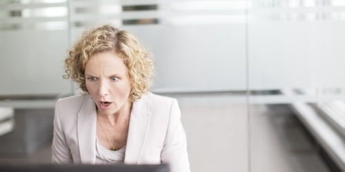 Worried Employee In Front of Computer