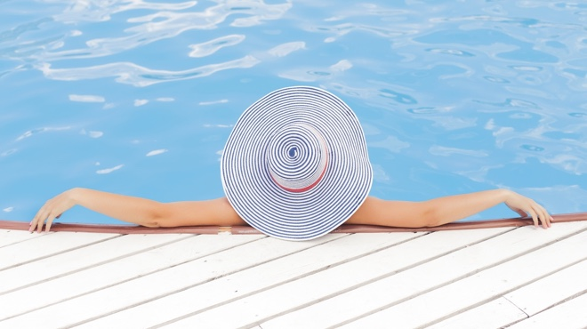 Women with Hat Lounging in Pool